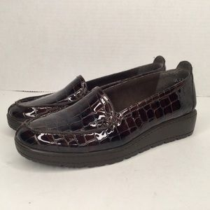 Stuart Weitzman patent leather brown shoes.